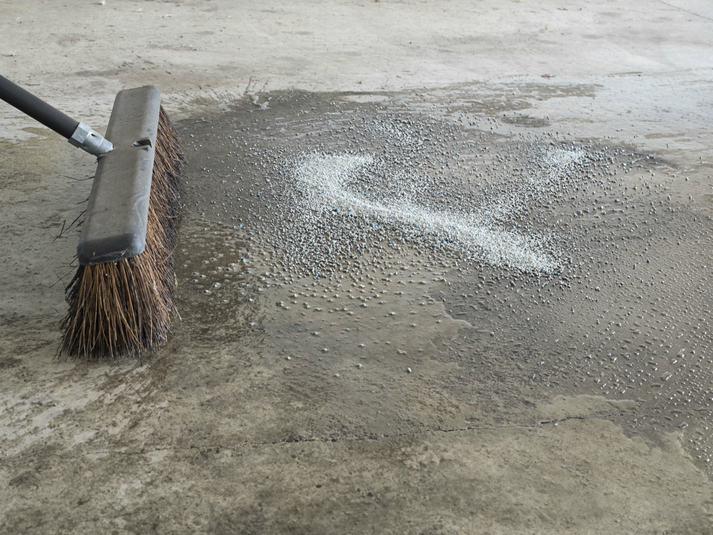 How to Epoxy a Garage Floor - prepare the floor by sweeping it